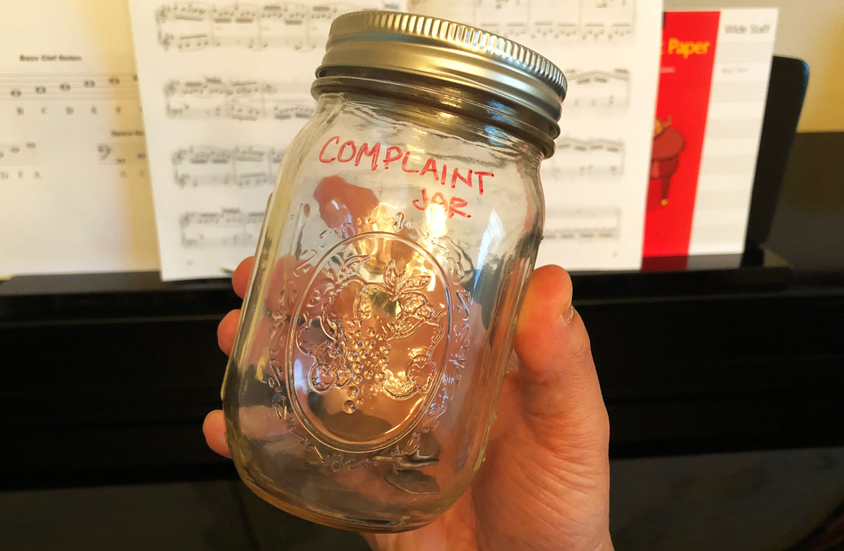 The Complaint Jar with Quarters in it.